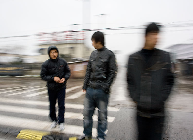 Three men crossing thestreet